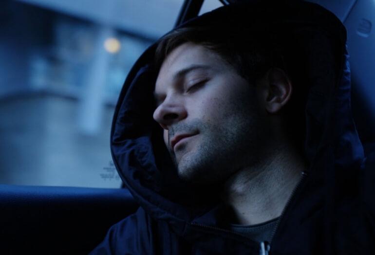 Man sleeping while wearing the Hypnos Hoodie
