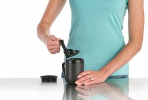 Woman using the Zyliss HotBrew Mug