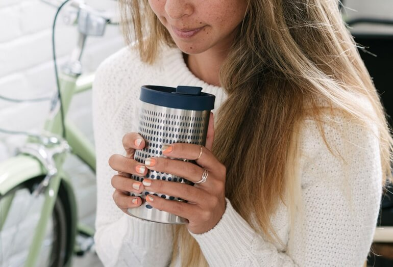 Woman Enjoying Coffee from the Bobble Presse