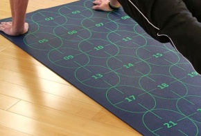 Man using Yoga by Numbers Mat