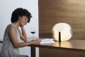 Woman Reading Using Lumio Lamp
